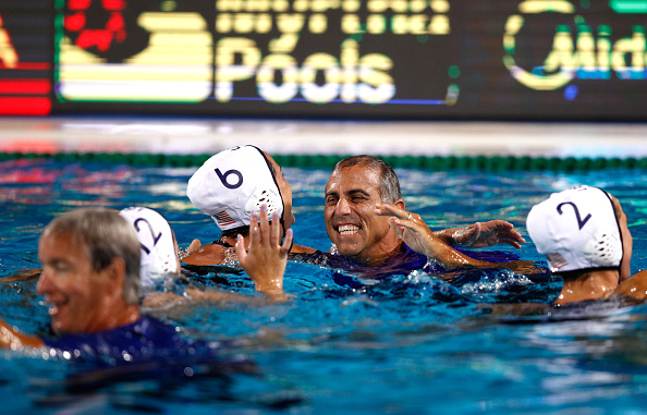 Coach Adam Krikorian and Maggie Steffens in the pool moments after the U.S. women had beaten Spain // Getty Images