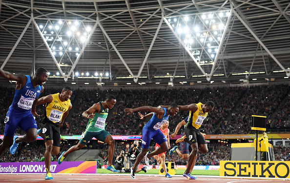 Justin Gatlin, left, at the finish line // Getty Images