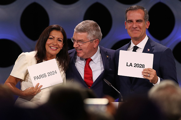 Paris mayor Anne Hidalgo, IOC president Thomas Bach, LA mayor Eric Garcetti at the moment the double-double becomes a done deal Wednesday in Lima // Getty Images