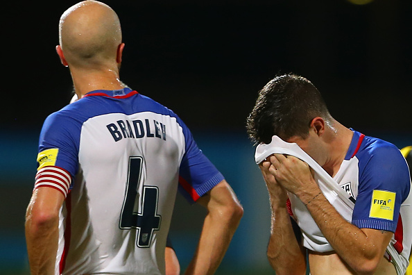Michael Bradley and Christian Pulisic react to the U.S. loss // Getty Images