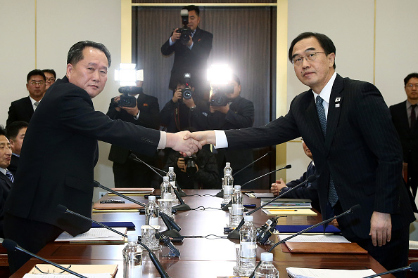 North Korea's Ri Son Gwon and South Korea's Cho Myoung-gyon shake hands during Tuesday's meeting at the Peace House in the village of Panmunjom in the DMZ // Getty Images