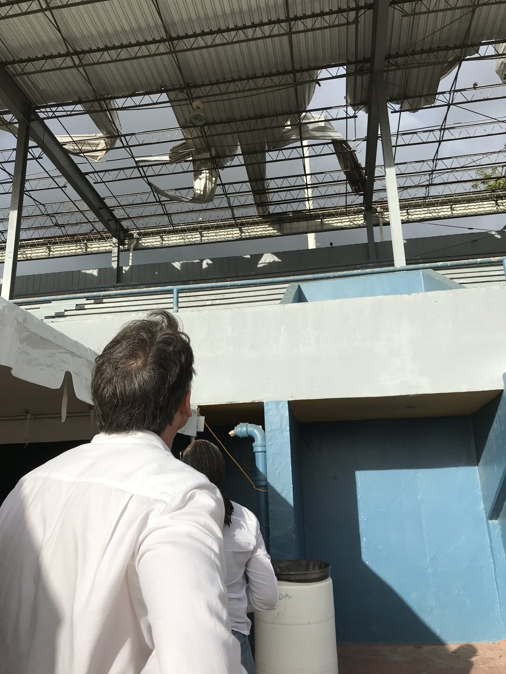 IAAF president Seb Coe surveying roof damage at a track and field stadium in the San Juan suburb of Toa Boa