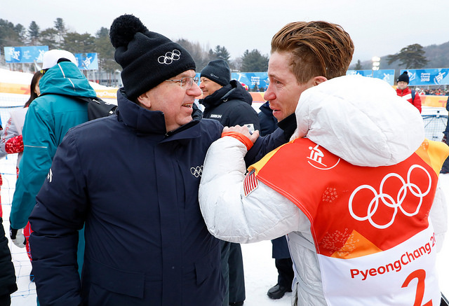 IOC president Thomas Bach with Shaun White's after the snowboarder's 'sick' run to gold // IOC via Flickr