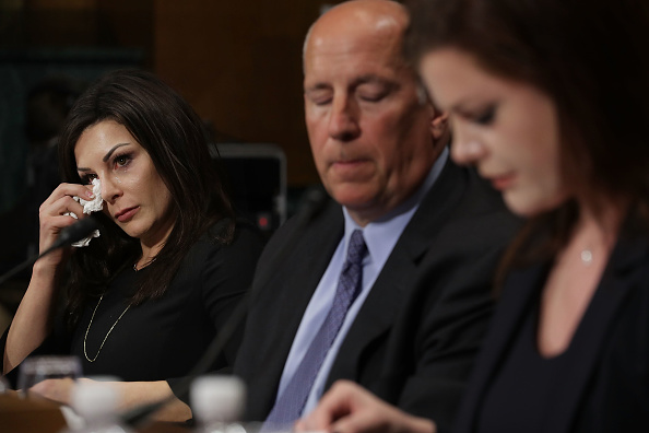 Jamie Dantzscher, left, last March before a Senate panel // Getty Images