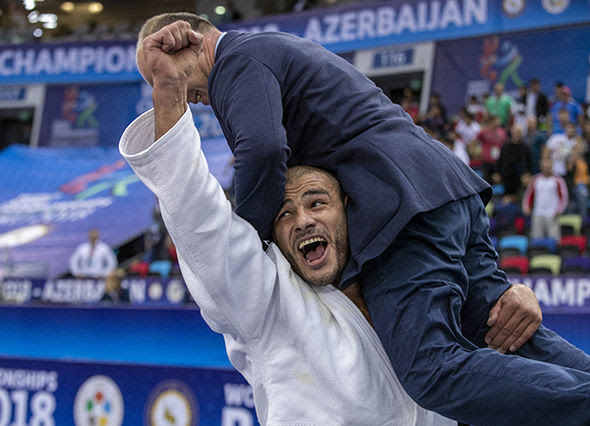 Georgia's Guram Tushishvili in victory with his coach // IJF