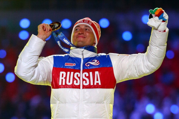 Alexander Legkov atop the medals podium in Sochi in 2014 // Getty Images