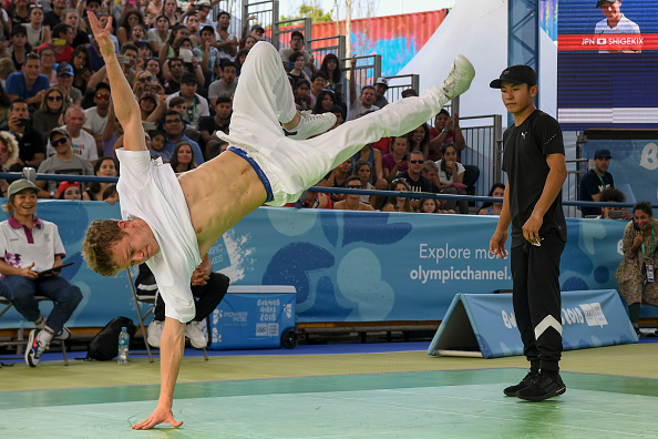 Russia's Bumblebee, left, competes against Japan's Shigelix during a Buenos Aires 2018 breakdancing — or in Olympic jargon, 'breaking' — competition // Getty Images