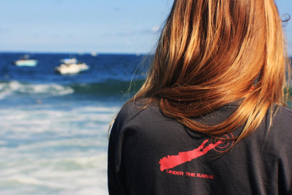 Aubrey grey tee back logo looking at the boats.jpg