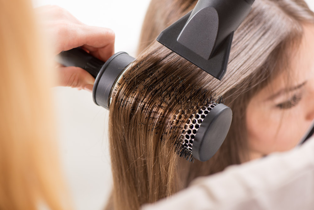 stock-photo-drying-long-brown-hair-with-hair-dryer-and-round-brush-close-up-197226602.jpg