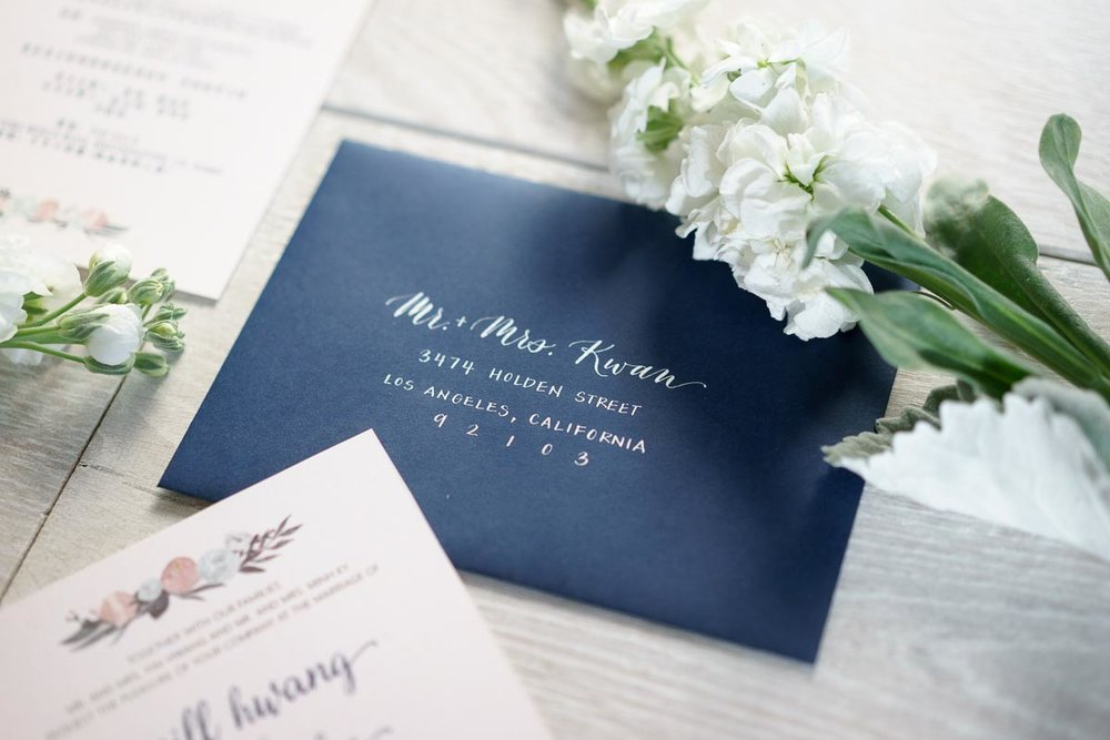 Navy and blush wedding invitations rae lily it would be fun to have a few calligraphy envelopes for photos and memories sake so i got to address a few with fake names and addresses of course stopboris Images