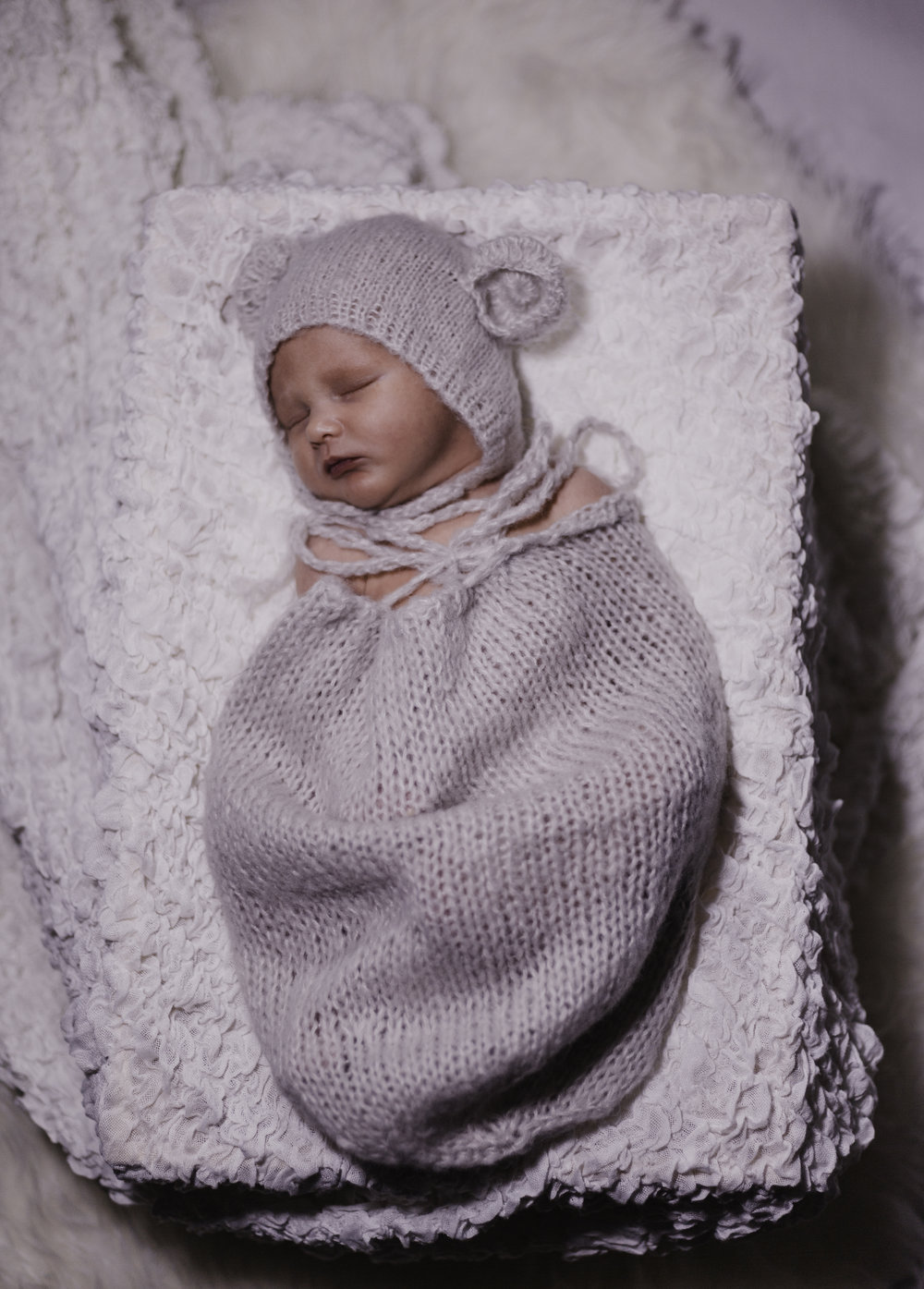 Newborn baby photoshoots - these photoshoots are so very precious to us. Capturing your newborn baby in the first few weeks is the best time, you then have the most beautiful photographs to look back on for a lifetime.