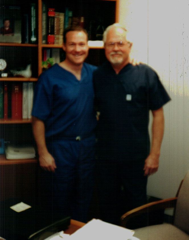 Dr. James Criscione and his son smiling in his office