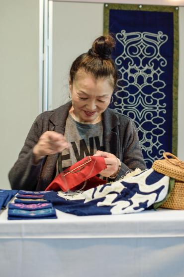 Ainu Lady Sewing Toyama.jpg