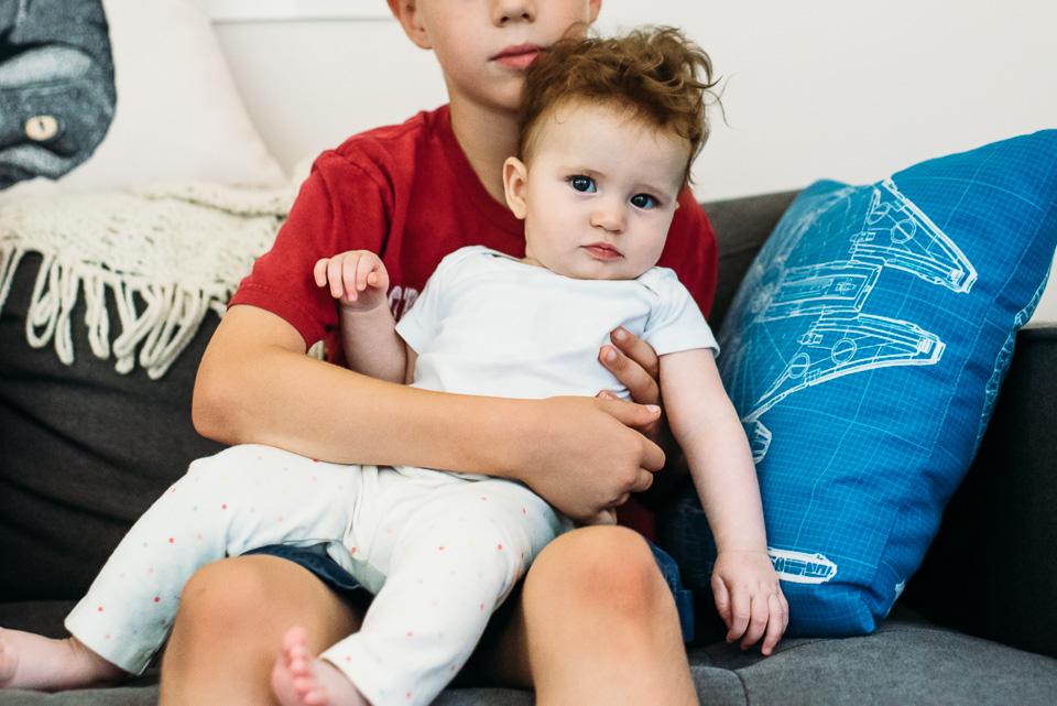 Boy holding baby girl cousin