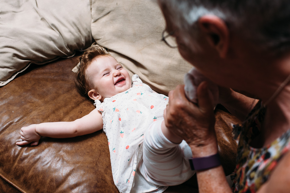 Grandma tickling baby's toes