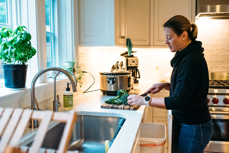 A mom prepping dinner in a beautiful kitchen.