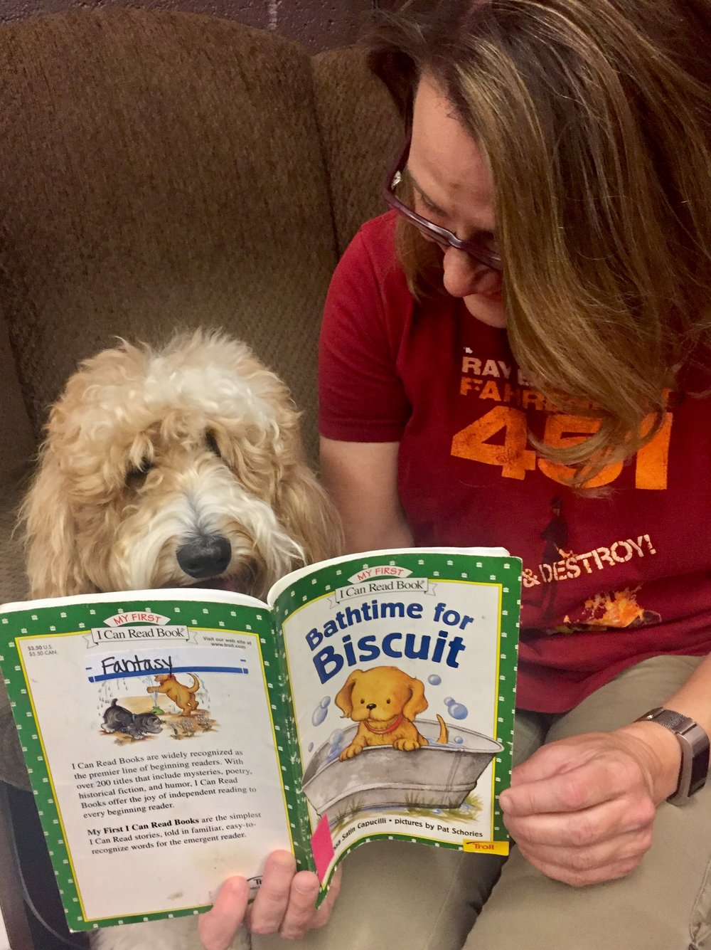 Bernie McSquare and I snuggle up in the comfy chair of the kids section at Bookmans Used Books to read Bathtime for Biscuit together.