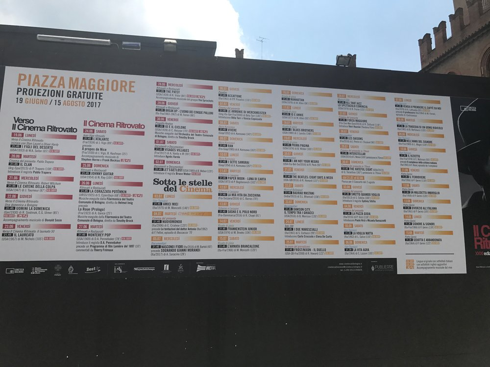 The Festival program posted in the Piazza Maggiore. It was really hard to get all of it into one shot!