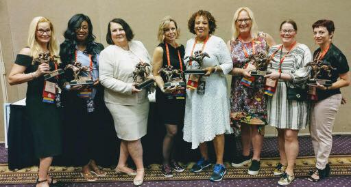 group photo with awards.jpg