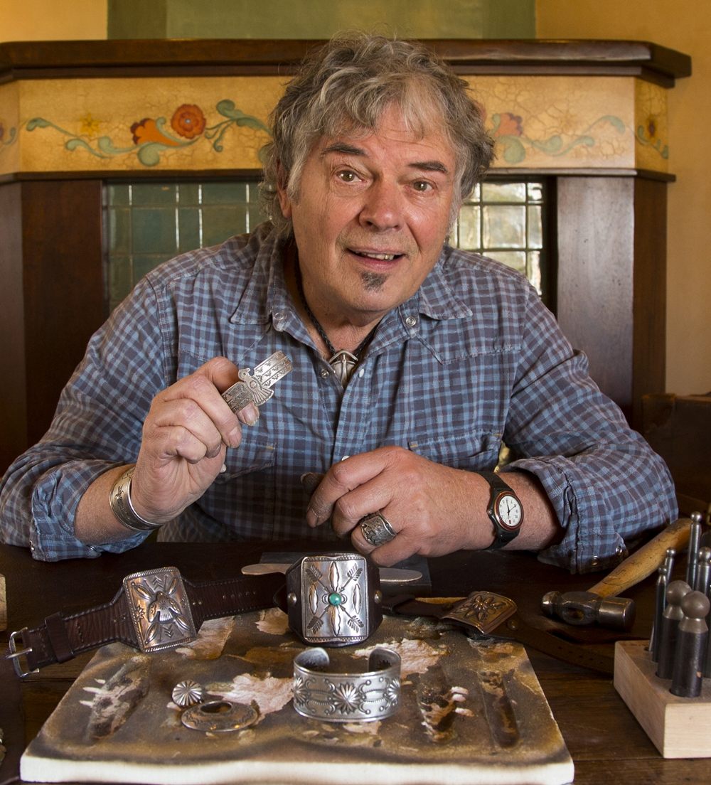 "BUFFALO - The silversmith known as ""Buffalo"" is included in a small group of contemporary artists that use traditional methods to design and fabricate their works. With almost 40 years of experience, he is considered a master of his craft.Often reminiscent of vintage Navajo work, several of Buffalo's pieces are displayed in various museums throughout the country. Buffalo is renowned for his classically designed ""Ketos,"" (pronounced Ke-toh), or bowguards. Bowguards were traditionally worn by Native Americans to decoratively protect their inner arm from the arrow fletchings when loosing a bow. Buffalo's rendition of this classic style incorporates true vintage saddlewear–vintage leathers and bolts–into the pieces, which serves to elevate his uniquely stamped bowguards and cuffs.Buffalo is a renowned recluse with beginnings in Pagosa Springs, Colorado. Buffalo now resides in Santa Fe, NM, where he continues to work day and night at his bench."