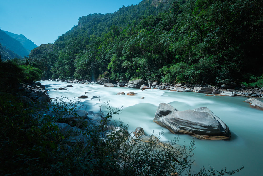 The Buddhi Gandaki River flows downriver through the lush valley.