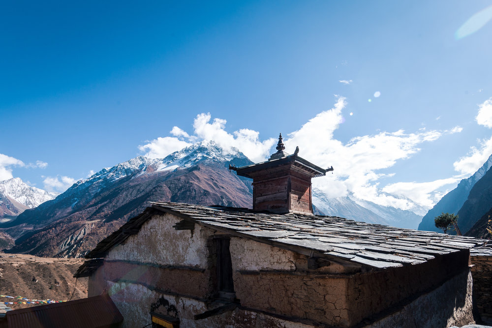 The monastery of Mu Gompa overlooking the mountains in the distance.