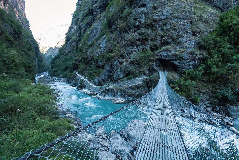 Crossing the Buddhi Gandaki River leading into a narrow gorge on the trail up to Mt. Manaslu.