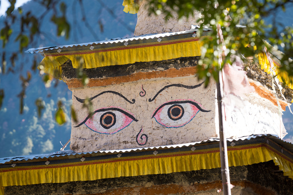 The ever-present eyes of Buddha on stupas overhead.