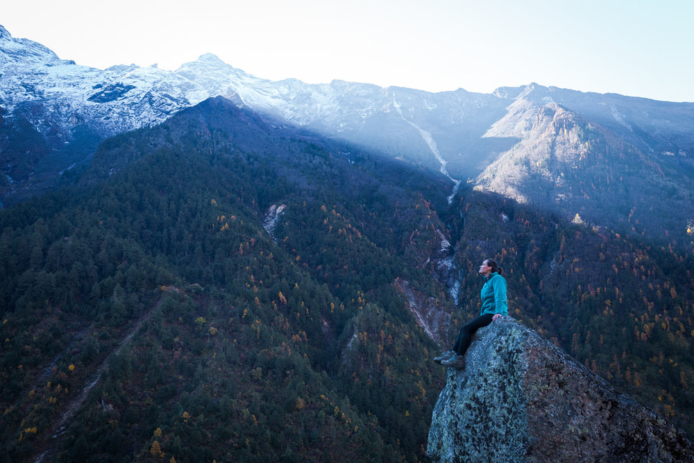 Taking in the beauty of the sunrise over the mountains above.  Image by Aleisha Moore.