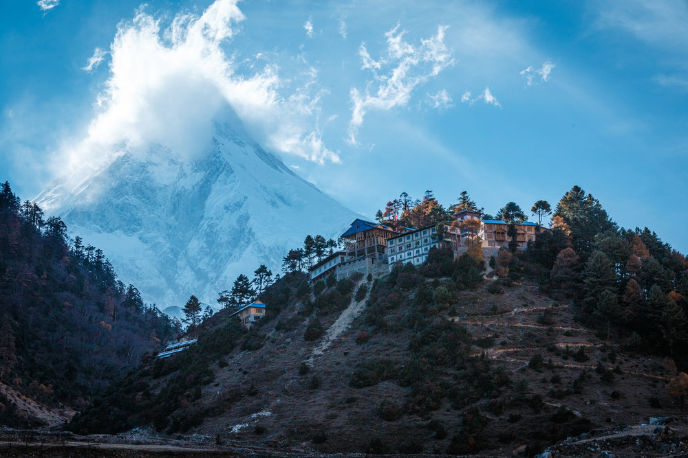 Mt. Manaslu (8,106m) smoking above the village of Lho.