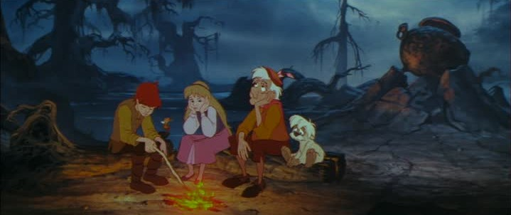 Taran, Eilonwy. Fflewddur, and Gurgi with the titular Black Cauldron from the Disney film