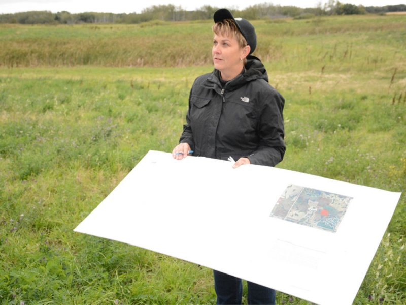 Pam Iwanchysko describing her grazing plan while standing in one of the planned grazing pastures during a tour on September 10, 2015