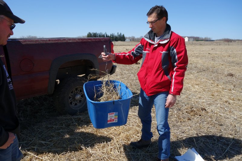 Shawn Cabak (MBAG) weighs a forage residue sample in April of 2016