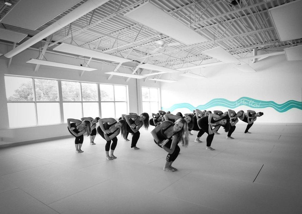 Betsys-hot-yoga-louisville group side twist.jpg