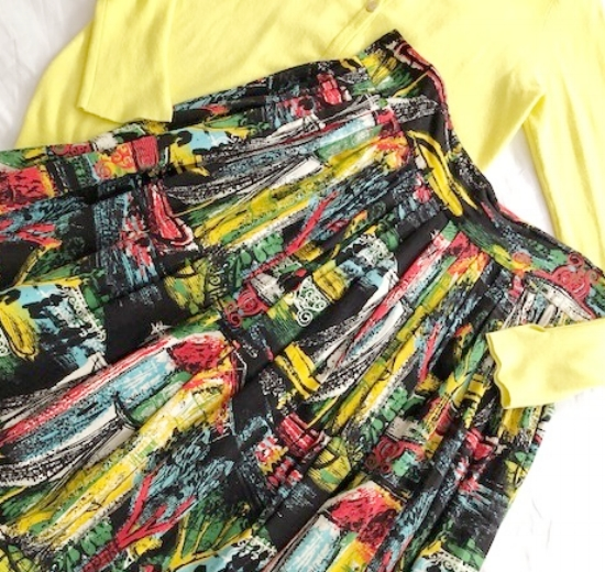 """My very first vintage piece purchased 36 years ago.A 1950's Bark Cloth Skirt with a metal zipper. The print is called """"Paris Night Scene"""". And I'm still wearing it!"""