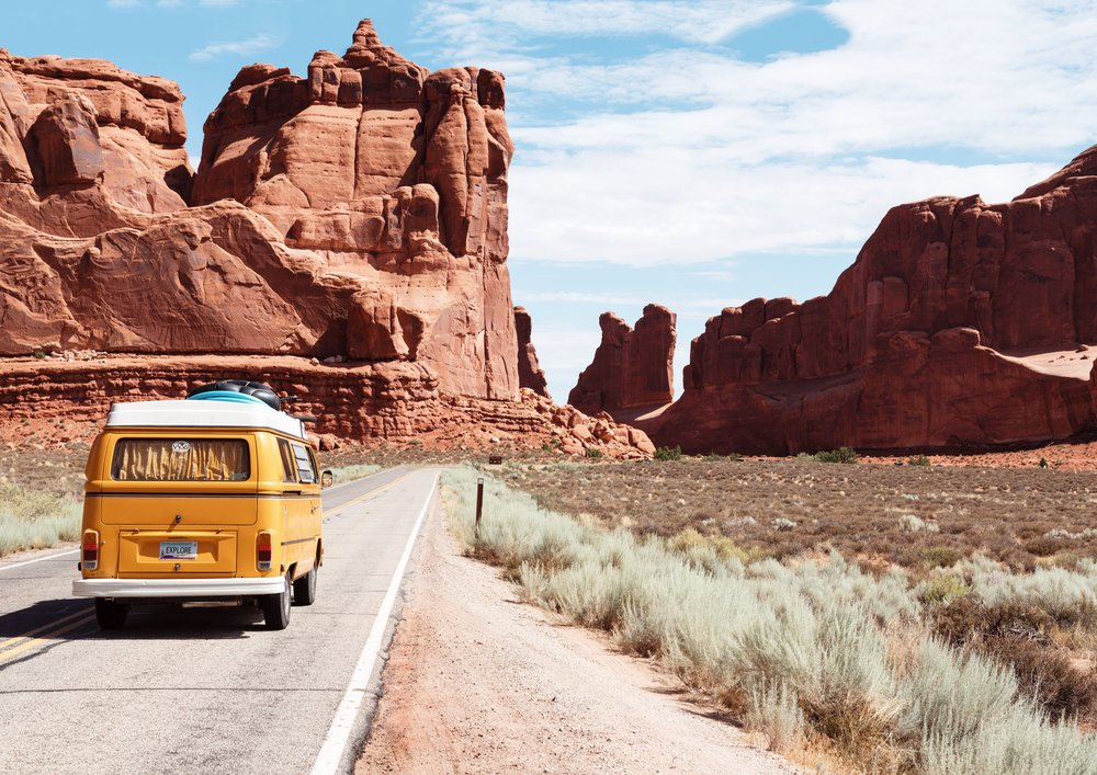 van driving down the road in the american southwest
