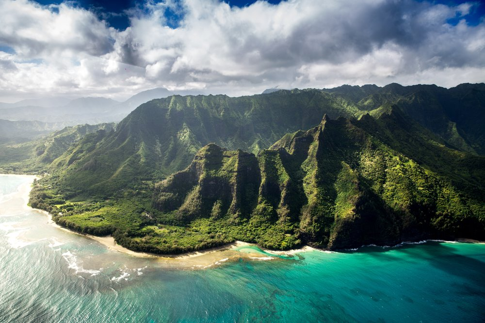 Green mountains in Hawaii by the ocean