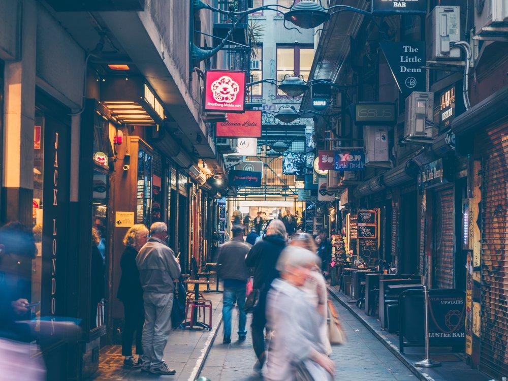 bustling street scene in Melbourne with lots of restaurants