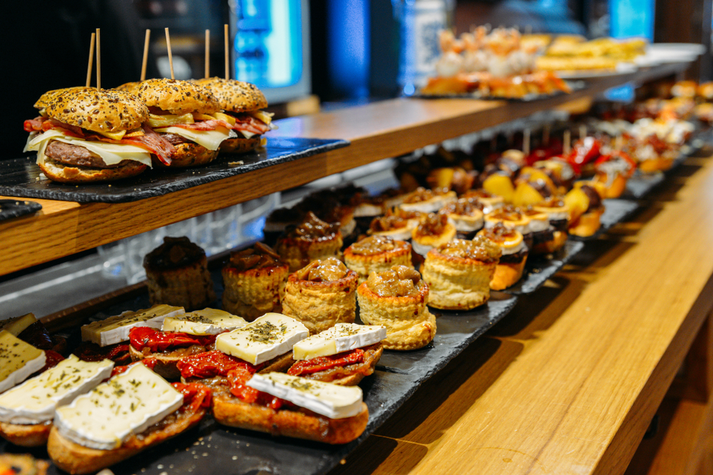 pintxos laid out on a counter in bilbao spain