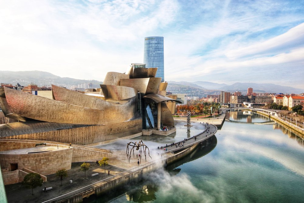 nice day with clouds at the guggenheim museum by the canal in Bilabo Spain