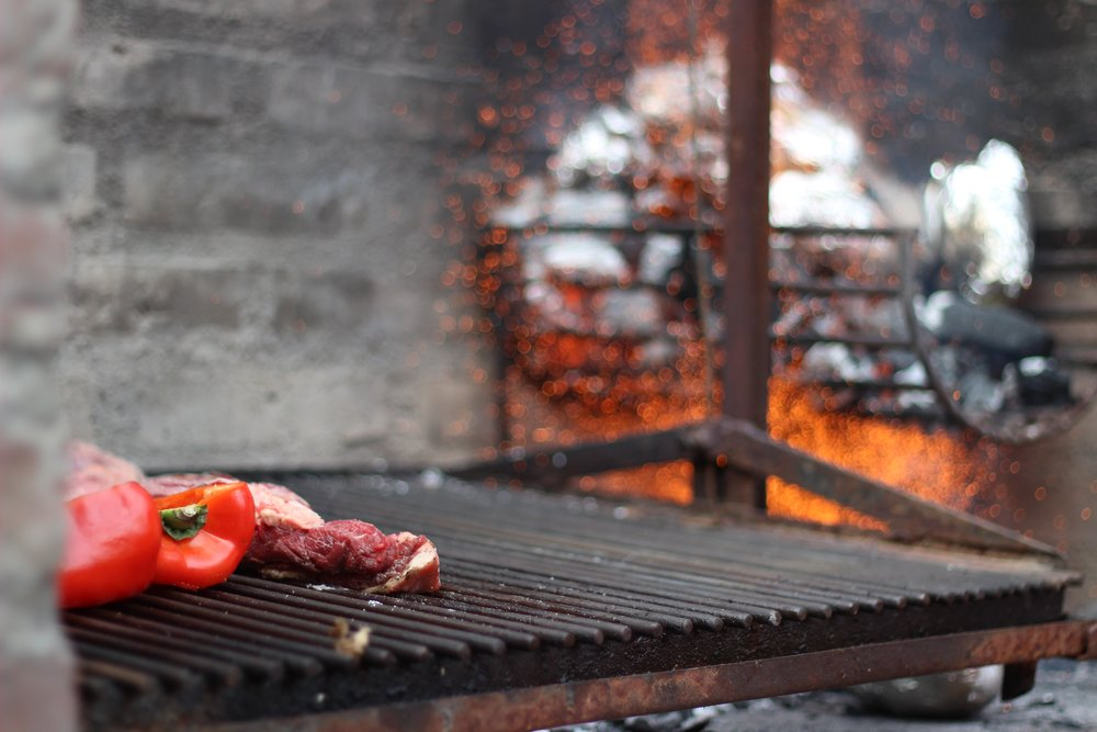 meat and pepper on the parilla (grill) in buenos aires argentina