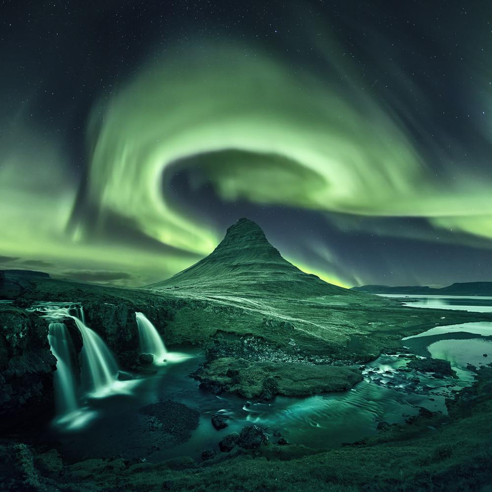 kirkjufell aurora borealis northern lights iceland waterfall night composite.jpg