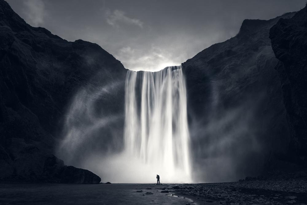 skogafoss iceland waterfall amazing wind cloudy dramatic.jpg