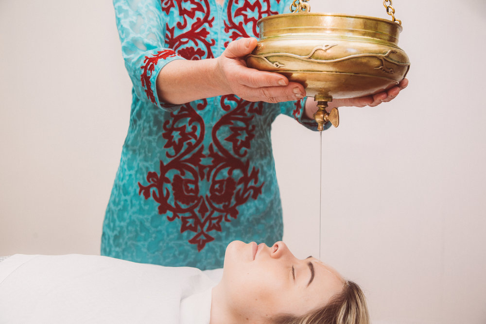 Shirodhara - is the pouring of medicinal liquids (oil, buttermilk, ghee) across the forehead. It specifically nurtures the region of the third eye, connected to the master gland of the body, the pituitary and it also creates a profound sense of peace and calm.