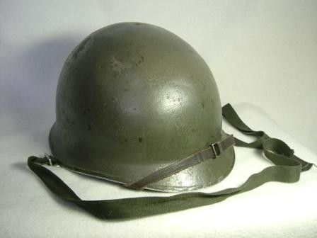 Type 66 Steel Helmet:   The first domestically produced combat helmet of post war Japan. Based off American M1 helmet shells with a liner designed for Japanese heads.  Early models used IJA Type chinstraps and later models where retrofitted or came with a two point chinstrap.  While no longer used for front line combat troops, Type 66 Helmets can still be seen in use with Reservist and rear echelon troops.