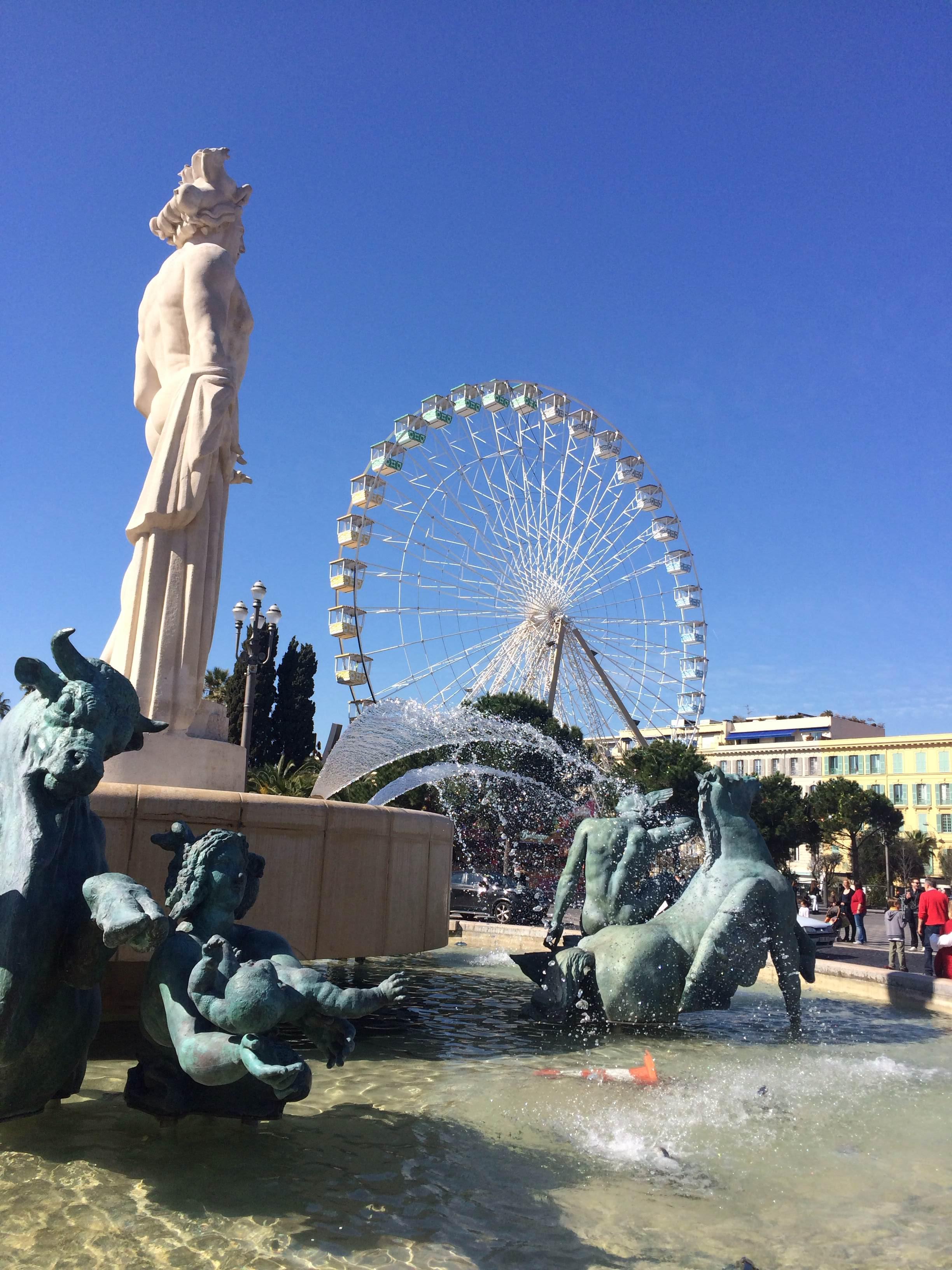Ferris Wheel, fountain and clear blue skies