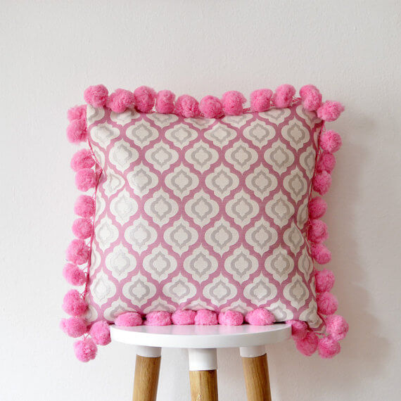 Pink elephant pom pom cushion