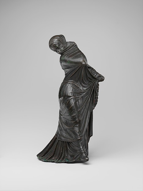 Bronze statuette of a veiled and masked dancer,  Metropolitan Museum of Art