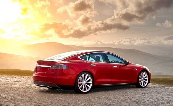 red_tesla_model_s_with_chilld_and_easy_entry_modes.jpg