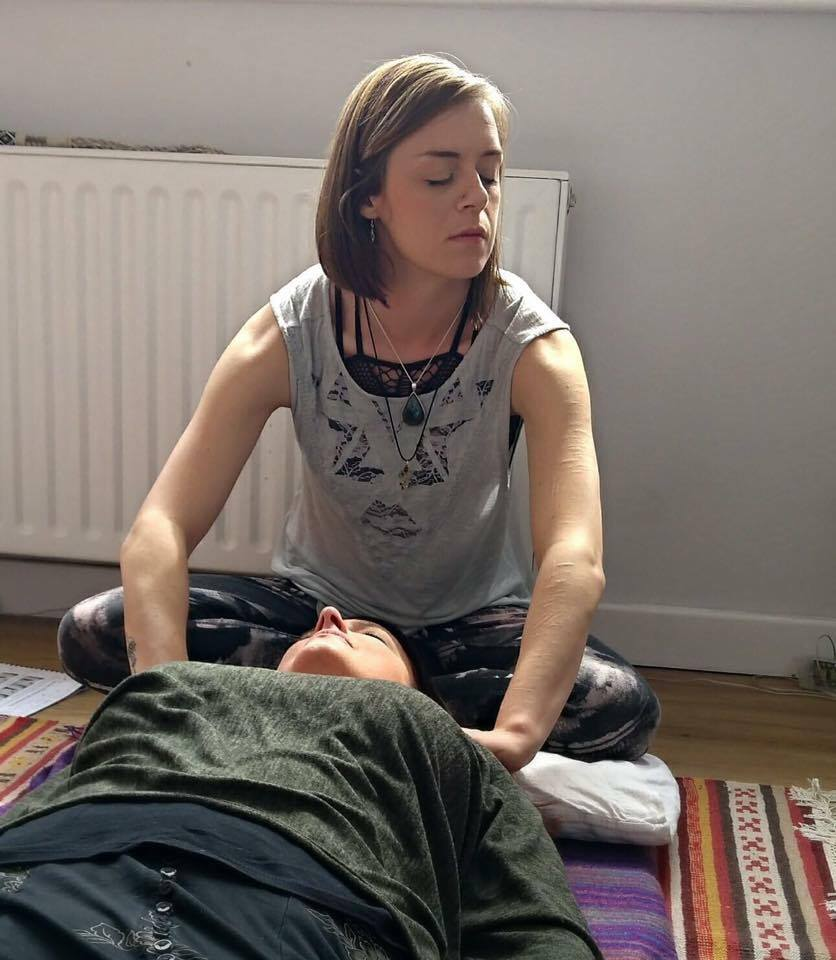 Rachael performing a shamanic energy healing